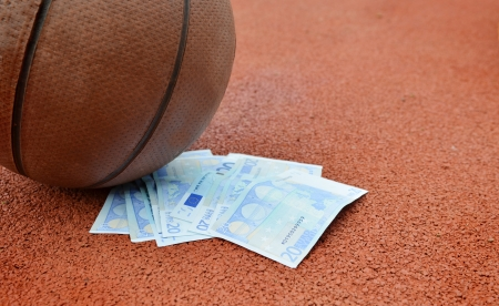 Basketball and Euros money on a court  Concept for sports economy photo