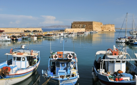 Iraklion fishing port with venetian castle in background