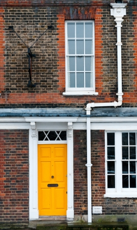 english house: Traditional English house yellow door entrance