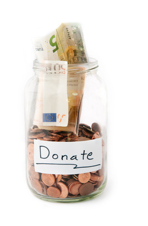 Jar full of with money from charity donation   photo