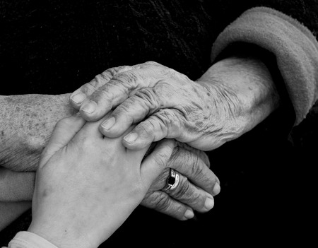 Child and grandmothers hand
