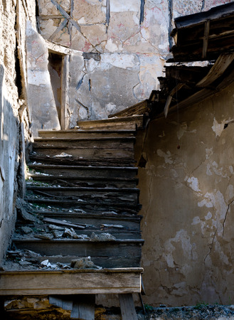 abandonment: Old abandoned damaged and dangerous wood stairs  Concept of abandonment