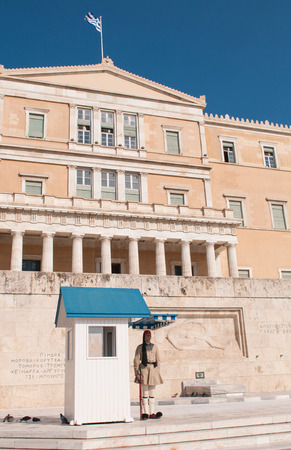 Athens, Greece - August 28: Evzone in front of the tomb of the Unknown Soldier and Greek parliament building on August 28 in Athens Greece.