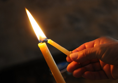 Lighting the candle for pray and make a wish.