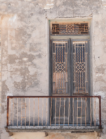 entranceway: Old closed deserted metallic  traditional door. Stock Photo
