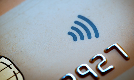 Details of Credit card with a chip an the contactless symbol photo