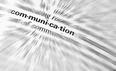 communication: Close-up of  the  word Communication with Radial blured applied