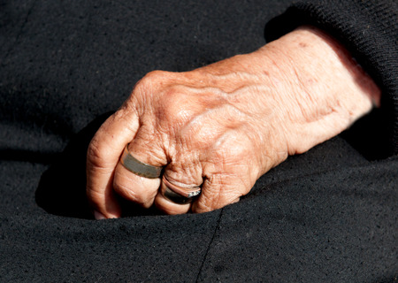 aging process: Senior womans aged hand with fingers closed. Concept of aging process.