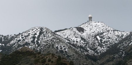 repeater: Telecommunication repeater station  at kionia area Kionia  in Cyprus with mountains covered in snow.