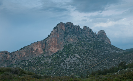 Famous Pentadaktylos rocky mountain peak in near Kerynia town in Cyprus late in the evening. It is named as five finger mountain because of the five peaks. Banco de Imagens