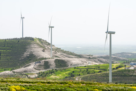 energy sources: Windmills turbine  power generator farm in Cyprus, generating electricity from wind. Generating electricity from renewable energy sources helps to save the environment from environmental pollution caused by other energy sources such as oil or  fossil fuel
