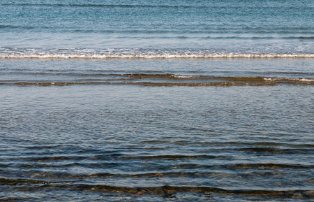 shallow water: Beach with shallow water, small waves and clean blue sea