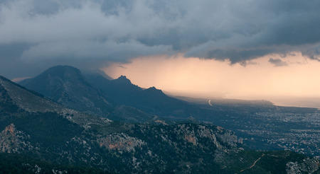 stormy clouds: Idyllic Landscape during sunset with mountain peaks and dramatic stormy clouds at Pentadaktilos mountain range in Kerynia area , in Cyprus