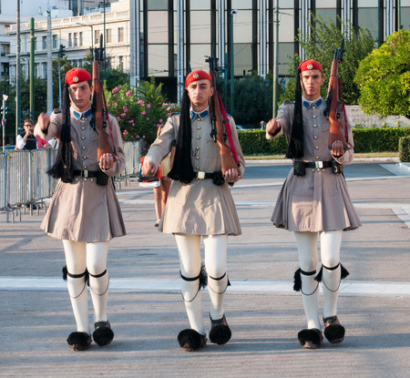 evzone: Athens, Greece - August 29, 2014 : Greek Evzone soldiers dressed in traditional greek military clothing, foustanella,   and marching in the parliament building square ready to change the guards Editorial