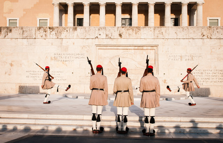 evzone: Athens, Greece - August 29, 2014 : Greek Evzone soldiers dressed in traditional greek military clothing  and marching in the parliament building square ready to change the guards Editorial