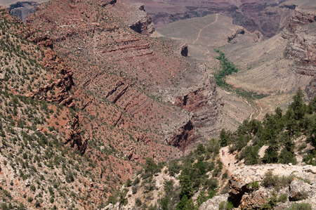 rock formation: Rock formation from Grand Canyon South Rim national park in Arizona USA with unrecognized people walking at the footpath. Stock Photo