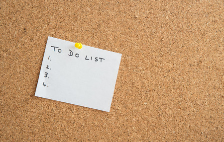 do: White paper with to do list message written on a cork board
