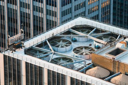 Rooftop of a modern skyscraper office building with huge  industrial  exhaustion fans