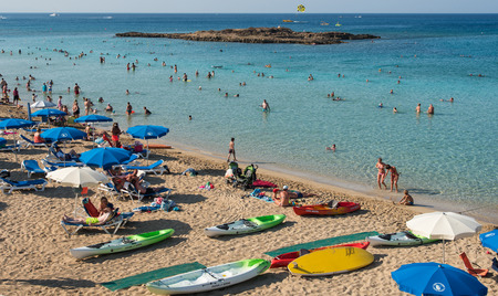 fig tree: PROTARAS,  CYPRUS -  JULY  14: Tourists at Fig Tree famous bay beach relaxing and  enjoying their summer holidays on July 14, 2015 at Protaras area in  Cyprus Editorial