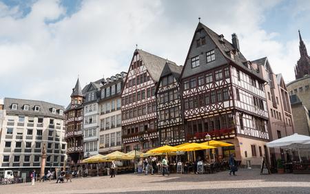 september 2: Frankfurt, Germany - September 2 2015: Tourists enjoying the famous historical landmark  of  Rmerberg square at the city of Frankfurt in Germany