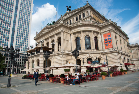 oper: Frankfurt, Germany - September 3, 2015: Famous old opera house building with people sitting at the opera cafe in  Frankfurt, Germany
