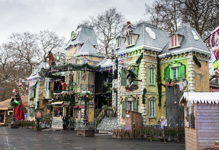 winter park: London, UK - December 10, 2015: Colorful  Horror house with horror statues  at Winter wonderland in Hyde park in London UK