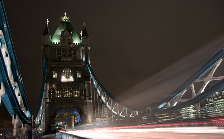 light traces: London, UK - December 10, 2015: London tower Bridge, UK, at night with cars and buses leaving colorful light traces.
