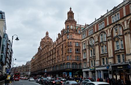 harrods: London, England - December 12, 2015: Urban landscape  in London city near Harrods luxury shopping center in United Kingdom.