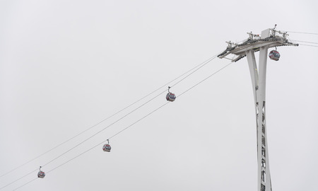 moody sky: Cable passenger  teleferic in London UK, with in a winter moody sky.