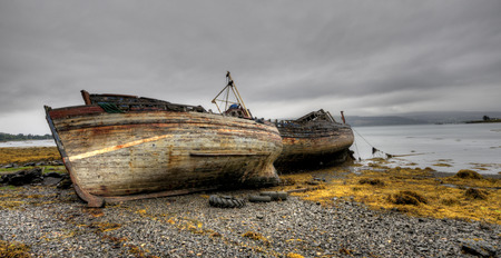 mull: Abandoned wooden fishing boats in the coast of the Isle of Mull in Scotland. Stock Photo