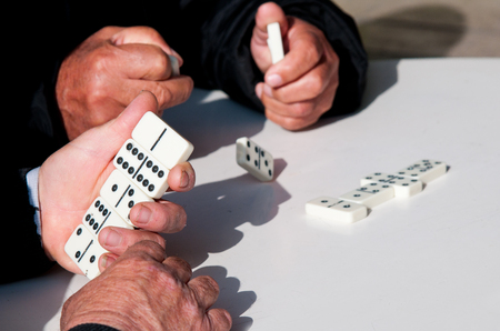 retiree: Mature retiree adults playing domino game for leisure