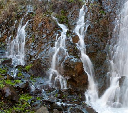 rocks water: Water flowing among rocks creating beautiful  waterfalls at Xyliatos dam area  in Cyprus .