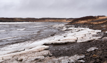 polar environment: Frozen lake with big ice cubes in the island of Iceland early in spring time Stock Photo