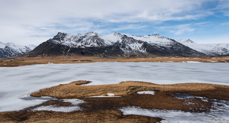 frozen lake: Typical Icelandic mountain landscape in Southeast Iceland  with frozen lake Stock Photo