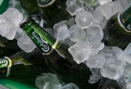Nicosia, Cyprus - May 7 2016: Small green bottles of famous Carlsberg beer on ice