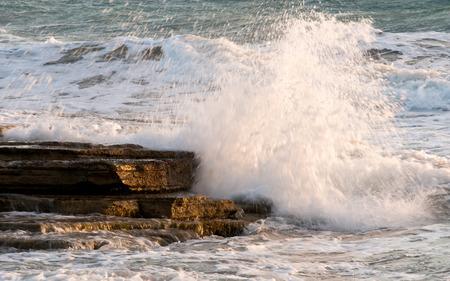 waves crashing: Dangerous Waves crashing with power on sea rocks. Stock Photo