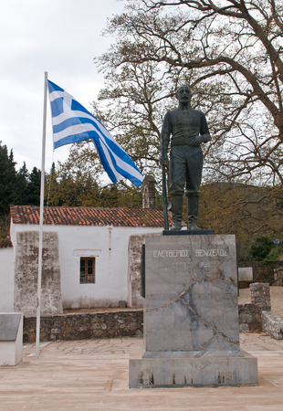 distric: Chania, Crete - April 7 2015: Famous Statue of Eleftherios Venizelos at the village of Therissos at Chania distric in the island of Crete, Greece with the greek flag on the side.
