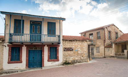 closed community: Traditional old clay houses painted with various colors at Vouni village in  Cyprus
