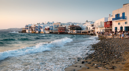 little venice: Mykonos, Greece - July 30 2016: Tourist people at little Venice walking and relaxing at the restaurants waiting for the sunset at Mykonos Island in the Aegean sea in Greece Editorial