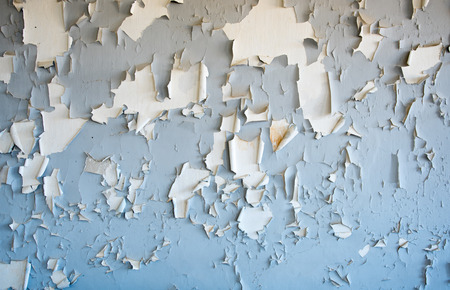 flaking: Blue flaking cracked paint on the surface of  a wall Stock Photo