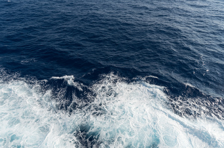 Blue Sea or ocean water surface  with waves from a cruis ship wake.