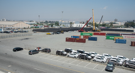 limassol: Limassol, Cyprus - June 29 2016: New cars and cargo ship container boxes at the industrial harbor of Limassol in Cyprus