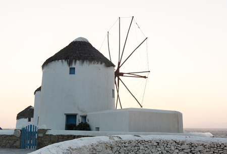 traditional windmill: Greek traditional windmill during sunset in the greek island of Mykonos Stock Photo