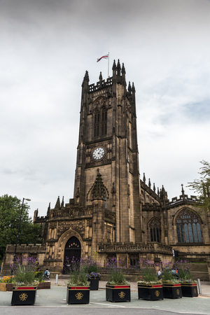 Exterior view of the famous medieval building of the cathedral of the city of Manchester in United Kingdom. Stock Photo
