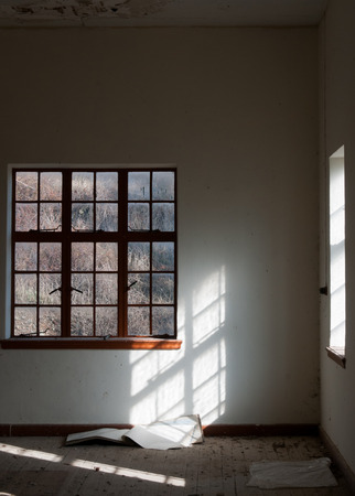 abandoned room: Empty abandoned room with windows and white walls Stock Photo