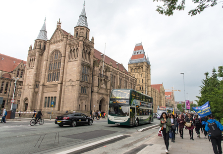 campus building: Manchester, England - September 21, 2016: Manchester University main campus building at Oxford road with students walking on the street Editorial
