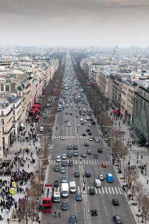 champs elysees: Paris, France - March 22 2013: Skyline of Paris city  in france with people and cars on the Champs Elysees avenue  from the top of Arc de Triomphe monument.