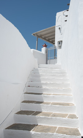 greek island: Traditional Greek island white stairs leading to the house entrance at the Island of Sifnos in Greece