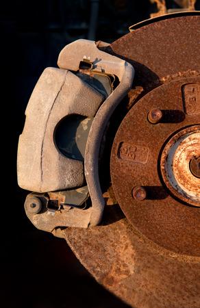 rusty car: Details of parts of a rusty car wheel brake