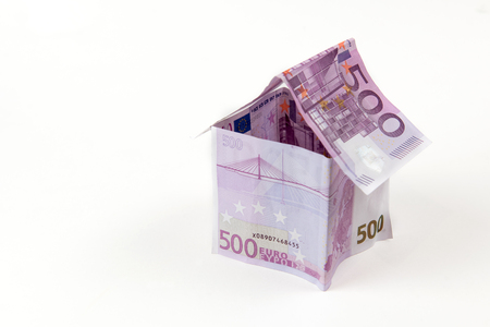 House made with 500 euro banknotes isolated on a white background